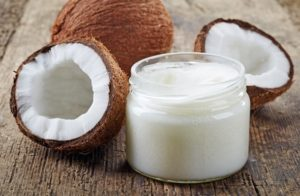 two-coconuts-and-coconut-oil-in-jar-without-lid